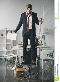 pictures to hang in office. Download Fired Businessman Standing On Chair And Trying To Hang Himself In Office Stock Photo - Pictures U