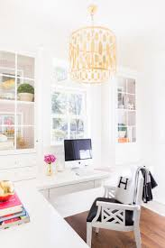 beautiful bright office. white and bright office space design with gold accent chandelier laura burleson interiors beautiful i
