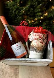 i like pairing my diy holiday cookie mix gift in a jar with a bottle of sutter home family vineyards wine in a sweet little basket lined with a holiday