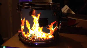 fire projected on a drum kit