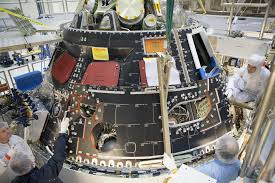 Engineers And Technicians Install Protective Shell On Nasas Orion
