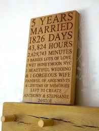 this is a personalised wooden 5th wedding anniversary wall plaque