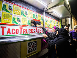 muslim customers line up and chow down at a taco trucks at every mosque event at