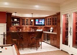 basement in spanish traditional basement also bar area beadboard backsplash crown molding game room home bar pendant lighting pool table red walls