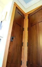 wood door bathroom custom walnut bathroom doors showcase glass knobs and are surrounded by fir molding wood door