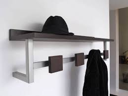modern chrome metal mixed black solid wood shelf with coat hook on white painted entryway wall