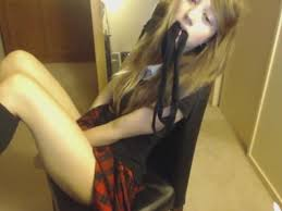 Girl masturbates in chair