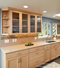 natural maple cabinets with caeserstone desert limestone counters with natural maple kitchen cabinets