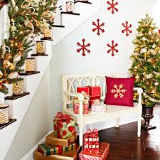 View in gallery Bold snowflakes in red on the wall add to the staircase  decorations [From: Lowe's