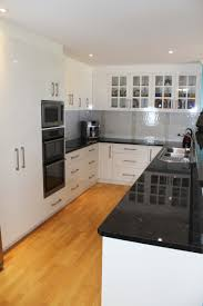 Mitre 10 Mega Kitchen Cabinets Black Benchtop White Cupboards Classic Style That Never Dates