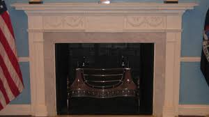 the ballroom fireplace is a hand me down from another historic manhattan home