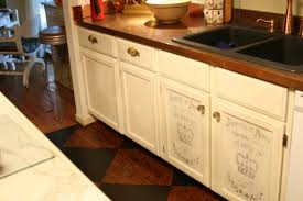 white chalk paint cabinet with butcher block countertop and black undermounted sink for small classic kitchen ideas