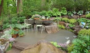 indoor rock garden ideas. Cozy Wrought Iron Chairs Feat Terracotta Flower Pots And Grasses On Stunning Rock Garden Design Idea Indoor Ideas