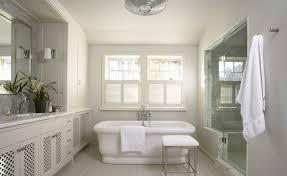 light grey and white bathroom. beautiful white \u0026 gray bathroom design with lattice cabinets, chrome stool, tub, glass shower and walls. light grey