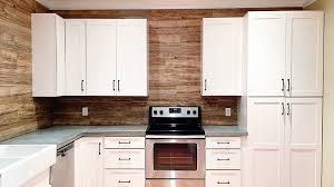 wood paneled walls are all the rage these days you can get that look in your kitchen but for much less money if you use laminate flooring for your