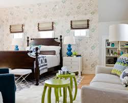 mismatched bedroom furniture. example of a transitional master medium tone wood floor bedroom design in boston with multicolored walls mismatched furniture