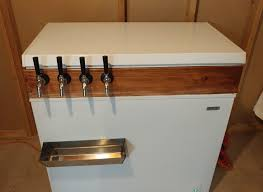 after building a sanyo kegerator and getting a lot of use out of it i realized that i needed a wider variety of beer on tap i did a little research on