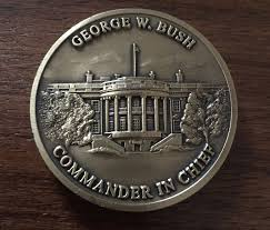 the flip side of president trump s challenge coin bottom along with those of from left vp pence joe biden and barack