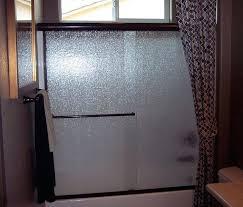 rain glass shower door tub enclosure with rain glass in bronze finish rain x glass treatment