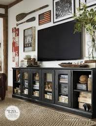 nice combo of pretty furniture + tv gallery wall Printer's Long Low Media  Suite