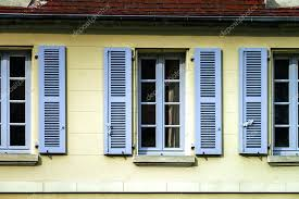 french shutters typical french windows with wooden shutters stock photo french door shutters