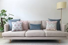grey sofa with pastel cushions in pink grey and blue