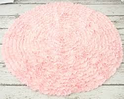 light pink round rug for nursery
