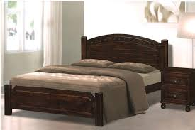 brown varnished wooden bed in classic style together brown bed sheet and also wooden headboard with