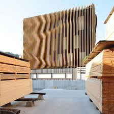 Wooden office buildings Eco Modus Architects Damiani Holz Ko Office Building Designboom Designboom Modus Architects Wraps Damiani Holz Ko Office In Waving Wood Fins
