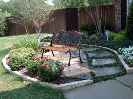 Seating area in your front yard nested into the landscape. Designed and  installed by Green