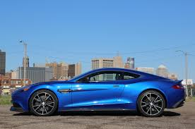 aston martin vanquish cobalt blue. one thing i do miss is the glove box there none in vanquish you can pick up a 2014 aston martin for of 282820 cobalt blue