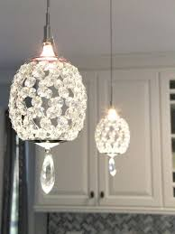 Elegant Crystal Pendant Lights Over A Peninsula Bring A Touch Of Glam To This  Transitional Kitchen. Design