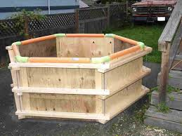 homesteader diy wood fired pool heater wood fired hot tub fire inside pipe spiral water rises