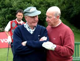 5 Peter Hinsley NGC member and official starter in deep conversation with Sir Bobby Charlton on the first tee AFMUP%