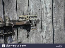 intricate metal lock system on old big wooden door stock image