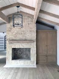 simple white stone fireplace design