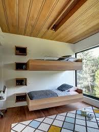 Trendy gender-neutral medium tone wood floor kids' bedroom photo in New  York with