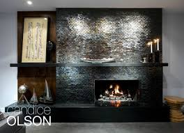 Clad in gorgeous iridescent pewter-finished glass tile, this fireplace  went from boring to spectacular!