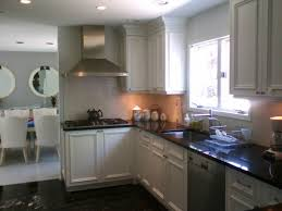 kitchen cabinet spray paintPainting Kitchen Cabinets White Before And After Spraying Kitchen