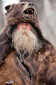 If it is true that wolves can be intimidated by the wearing of a wolf or bear  skin coat then maybe having the head placed in the torso area the wolves  would ...