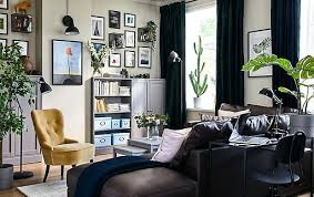 living room wall shelf this colourful small living space is filled with black picture frames glass