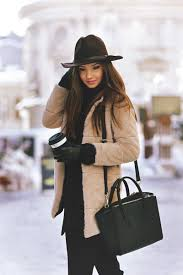 fluffy coat trend larisa costea is wearing a khaki faux fur coat from sheinside