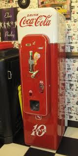 Coca-Cola Vintage Machine  I want this in my kitchen.
