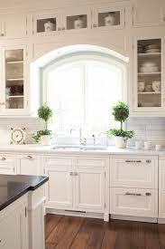 arch window over kitchen sink
