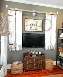 industrial pipe sliding barn door cover doors pipes and tv cabinet over fireplace