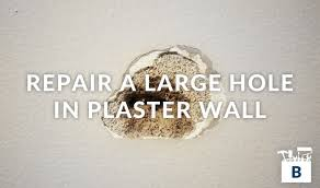 large hole in plaster wall