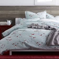 200 thread count cotton percale duvet cover featuring a charming print of birds nesting together