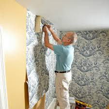 man hanging wall paper construction pro tips
