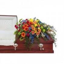 trered celebration casket spray