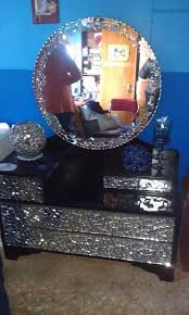 old dressing table painted black then mosaic with broken